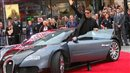 Tom Cruise on red carpet in Bugatti Veyron