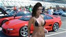 Sexy brunette infront of Toyota at Motor Show