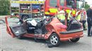 Boy racer crashes his orange Peugeot 206 and is lucky to be alive