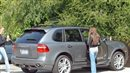 Miley Cyrus drives a Porsche Cayenne GTS