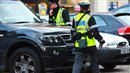 Two parking wardens assess a Range Rover